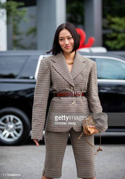 Tiffany Hsu is seen wearing brown checkered blazer and shorts outside Carolina Herrera during New York Fashion Week September 2019 on September 09...