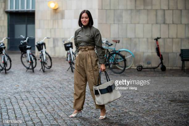 Tiffany Hsu is seen wearing brown pants, olive plaid top outside Saks Potts during Copenhagen Fashion Week Spring/Summer 2020 on August 08, 2019 in...