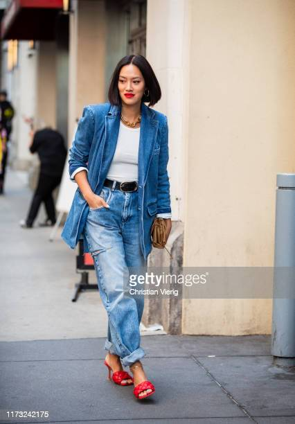 TIffany Hsu is seen wearing denim jeans and blazer outside Tibi during New York Fashion Week September 2019 on September 08 2019 in New York City