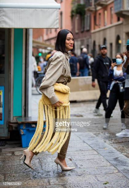 Tiffany Hsu is seen wearing khaki pants, yellow bag with fringes outside Max Mara during the Milan Women's Fashion Week on September 24, 2020 in...