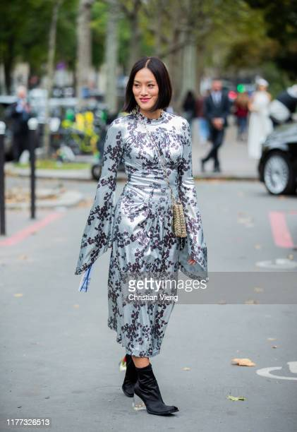 Tiffany Hsu is seen wearing light blue dress with floral print outside Paco Rabanne during Paris Fashion Week Womenswear Spring Summer 2020 on...