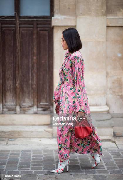 Tiffany Hsu is seen wearing pink dress with floral print outside Thom Browne during Paris Fashion Week Womenswear Fall/Winter 2019/2020 on March 03...
