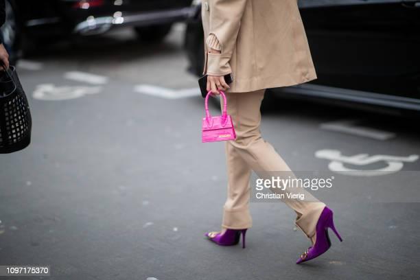 Tiffany Hsu is seen wearing pink mini Jacquemus bag, beige suit, purple velvet heels utside Acne during Paris Fashion Week - Menswear F/W 2019-2020...