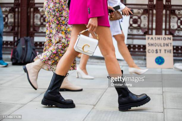 Tiffany Hsu is seen wearing white Chloe bag, black boots outside Victoria Beckham during London Fashion Week September 2019 on September 15, 2019 in...