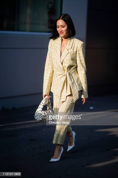 Tiffany Hsu is seen wearing yellow plaid suit outside Gucci on Day 1 Milan Fashion Week Autumn/Winter 2019/20 on February 20 2019 in Milan Italy