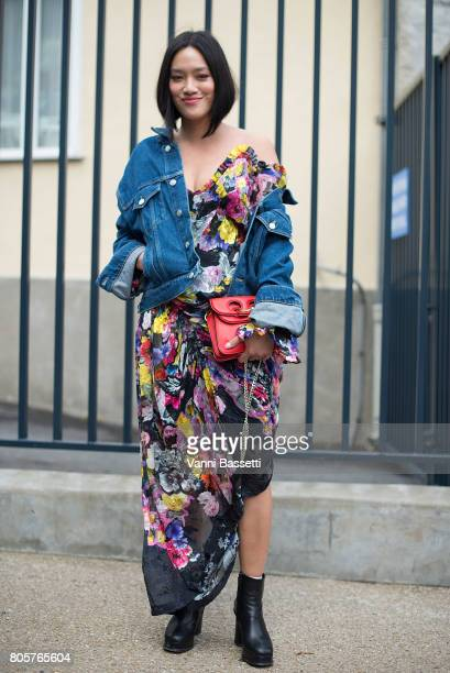 Tiffany Hsu poses wearing a Preen dress and JW Anderson bag before the Rodarte show at the Cloitre Port Royal during Paris Fashion Week Haute Couture...