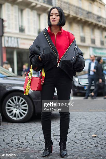 Tiffany Hsu poses wearing Vetements bomber jacket and Off White bag after the Valentino show at the Hotel Salomon de Rothschild during Paris Fashion...
