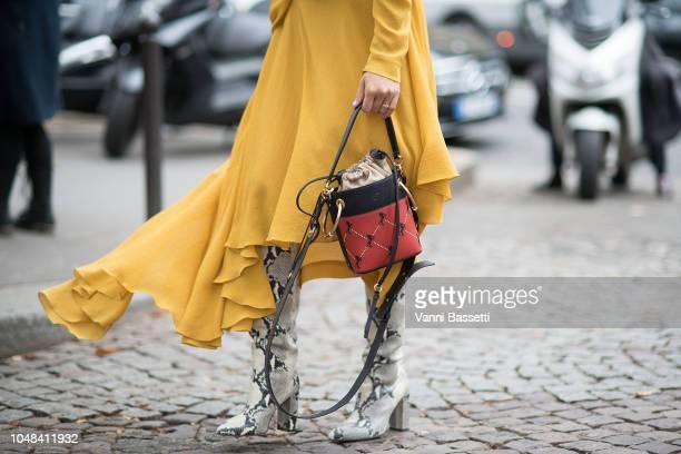 Tiffany Hsu poses with a Chloe bag after the Miu Miu show at the Palais de Iena during Paris Fashion Week SS19 Womenswear on October 2 2018 in Paris...