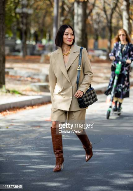 Tiffany Hsu seen wearing beige blazer shorts Bottega Veneta bag brown boots outside Sacai during Paris Fashion Week Womenswear Spring Summer 2020 on...