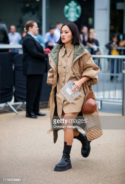 Tiffany Hsu seen wearing beige button up dress and trench coat in beige with olive brown bag outside Burberry during London Fashion Week September...