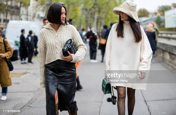 Tiffany Hsu seen wearing black leather skirt with slit, knit, boots with animal print, black and Yoyo Cao wearing hat, white knitted dress, sheer...