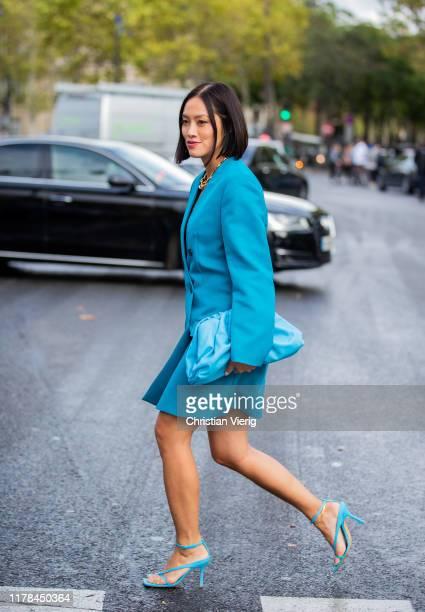 Tiffany Hsu seen wearing blue blazer Bottega Veneta pouch bag outside Miu Miu during Paris Fashion Week Womenswear Spring Summer 2020 on October 01...