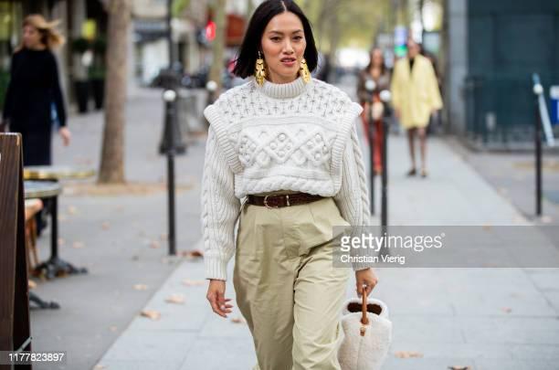 Tiffany Hsu seen wearing cropped knit, earrings outside Altuzarra during Paris Fashion Week Womenswear Spring Summer 2020 on September 28, 2019 in...