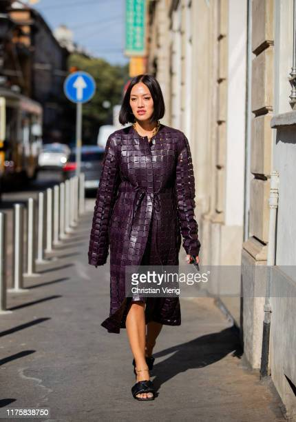 Tiffany Hsu seen wearing purple belted coat LIDO PS20 Bottega Veneta shoes outside Attico during Milan Fashion Week Spring/Summer 2020 on September...