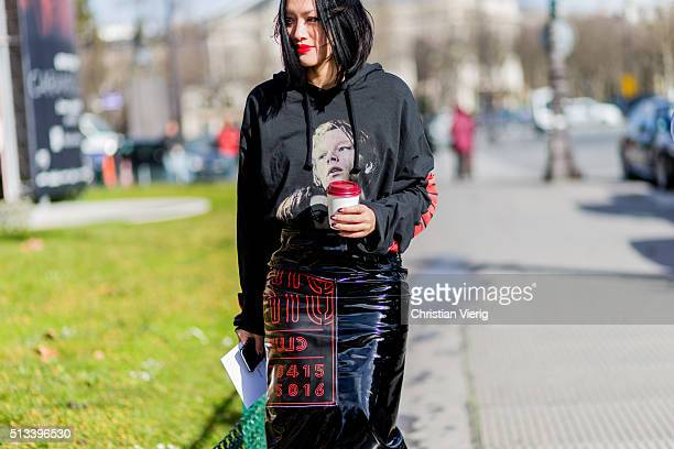Tiffany Hsu wearing a black hoody and skirt outside Maison Margiela during the Paris Fashion Week Womenswear Fall/Winter 2016/2017 on March 2 2016 in...