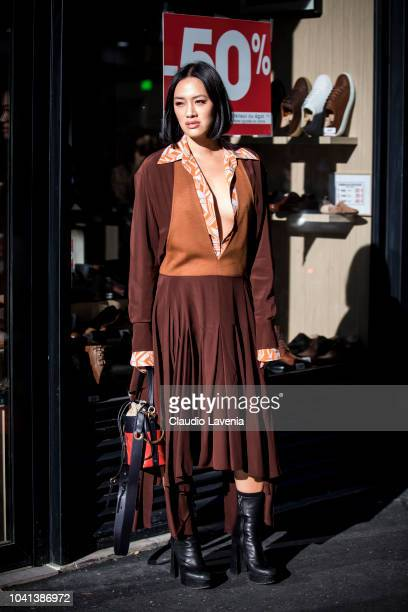 Tiffany Hsu wearing a brown dress black ankle boots and black and red bag is seen before the Mugler show on September 26 2018 in Paris France