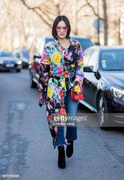 Tiffany Hsu wearing a floral button shirt cropped denim jeans JW Anderson bag outside Chloe on March 2 2017 in Paris France