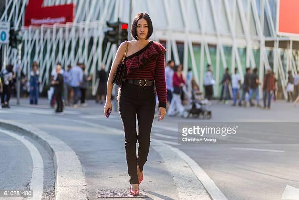 Tiffany Hsu wearing a Gucci bag outside Jil Sander during Milan Fashion Week Spring/Summer 2017 on September 24 2016 in Milan Italy
