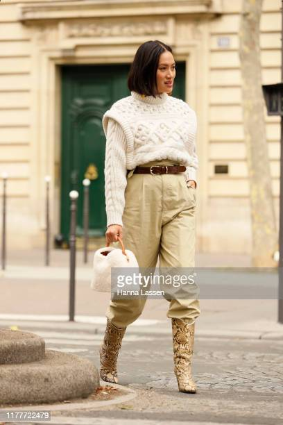Tiffany Hsu wearing a knit top and khaki pants with snake skin boots outside the Altuzarra show during Womenswear Spring/Summer 2020 show Paris...
