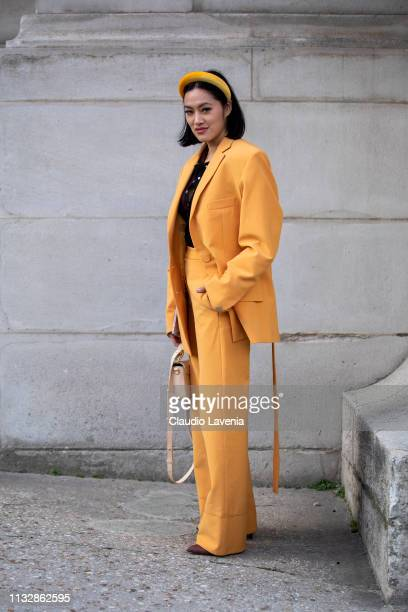 Tiffany Hsu wearing a yellow suit cream bag and yellow hairband is seen outside Paco Rabanne on Day 4 Paris Fashion Week Autumn/Winter 2019/20 on...