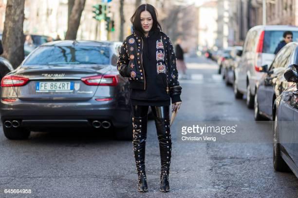 Tiffany Hsu wearing black jacket pants and overknees outside Marni during Milan Fashion Week Fall/Winter 2017/18 on February 26 2017 in Milan Italy