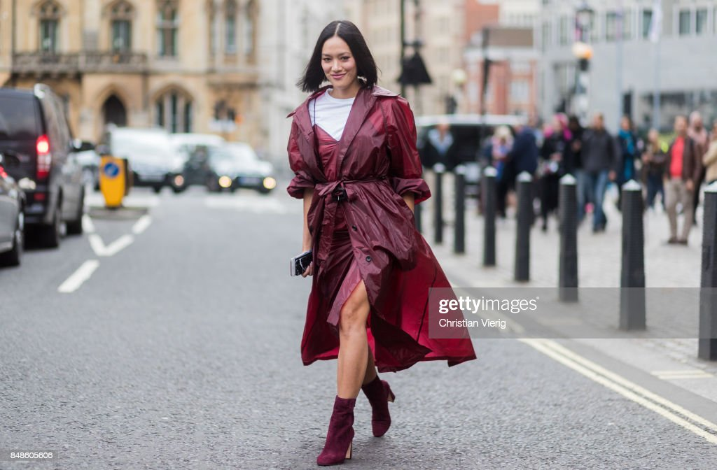 Tiffany Hsu wearing bordeaux coat outside Preen during London Fashion Week September 2017 on September 17, 2017 in London, England.
