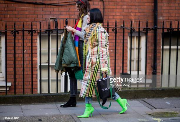 Tiffany Hsu wearing Burberry trench coat with neon touch neon boots ripped denim jeans Sculpture bag Burberry scarf seen outside JW Anderson during...