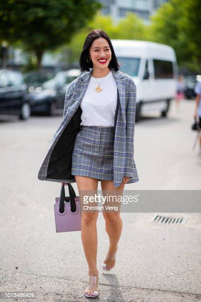 Tiffany Hsu wearing checked skirt and blazer pink bag is seen outside Cecilie Bahnsen during the Copenhagen Fashion Week Spring/Summer 2019 on August...
