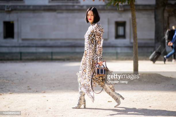 Tiffany Hsu wearing dress with leopard print is seen outside Elie Saab during Paris Fashion Week Womenswear Spring/Summer 2019 on September 29 2018...