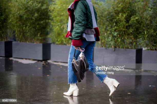 Tiffany Hsu wearing jacket cropped denim jeans white boots is seen outside Haider Ackermann during Paris Fashion Week Spring/Summer 2018 on September...