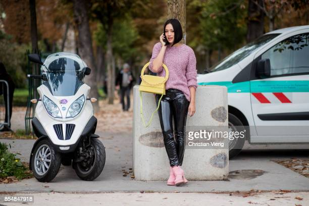 Tiffany Hsu wearing latex pants knit yellow pants is seen outside Lanvin during Paris Fashion Week Spring/Summer 2018 on September 27 2017 in Paris...