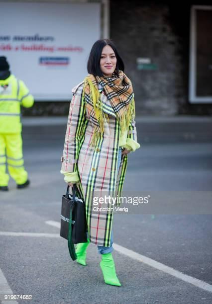 Tiffany Hsu wearing neon Burberry coat seen outside Burberry during London Fashion Week February 2018 on February 17 2018 in London England