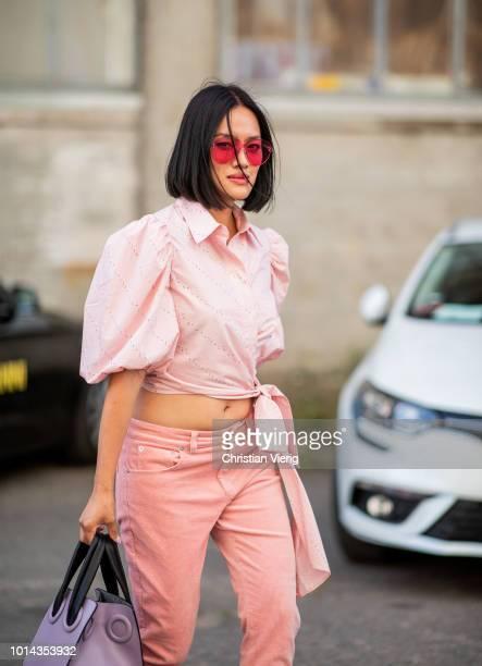 Tiffany Hsu wearing pink top, pink pants is seen outside Ganni during the Copenhagen Fashion Week Spring/Summer 2019 on August 9, 2018 in Copenhagen,...