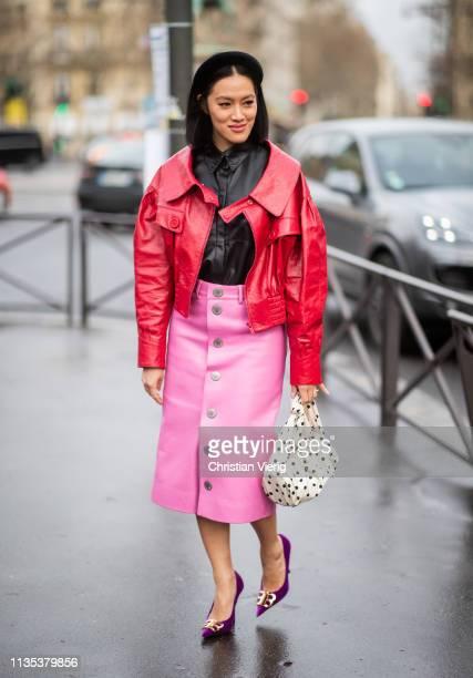 TIffany Hsu wearing red jacket pink skirt bag with dots print hair clip outside Miu Miu during Paris Fashion Week Womenswear Fall/Winter 2019/2020 on...