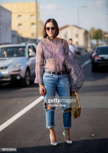 Tiffany Hsu wearing sheer blouse ripped denim jeans is seen outside Missoni during Milan Fashion Week Spring/Summer 2018 on September 23 2017 in...