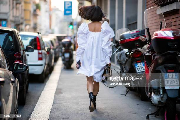 Tiffany Hsu wearing white Calvin Klein dress is seen outside No 21 during Milan Fashion Week Spring/Summer 2019 on September 19 2018 in Milan Italy