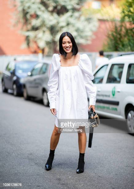Tiffany Hsu wearing white Calvin Klein dress seen outside Jil Sander during Milan Fashion Week Spring/Summer 2019 on September 19 2018 in Milan Italy