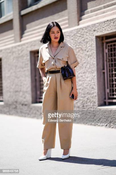 Tiffany Hsu wears a beige outfit and white shoes outside Acne Studios during Paris Fashion Week Womenswear Fall Winter 2019 on July 1 2018 in Paris...