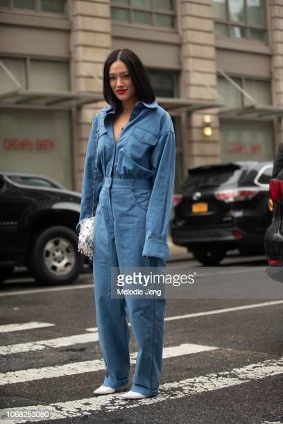 Tiffany Hsu wears a blue jumpsuit during New York Fashion Week Spring/Summer 2019 on September 9 2018 in New York City