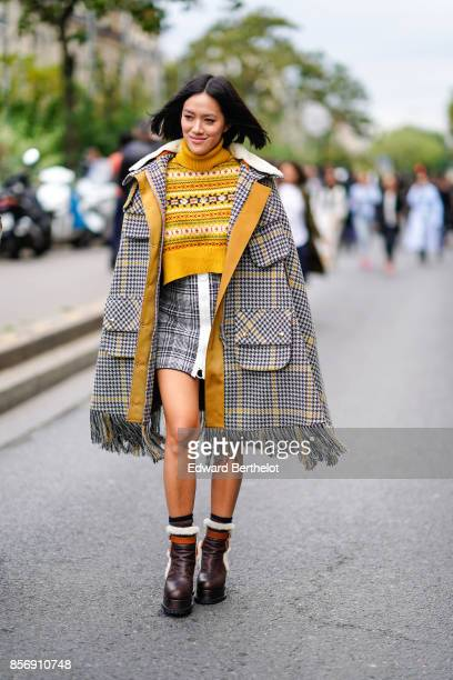 Tiffany Hsu wears an outfit with fringes outside Giambattista Valli during Paris Fashion Week Womenswear Spring/Summer 2018 on October 2 2017 in...