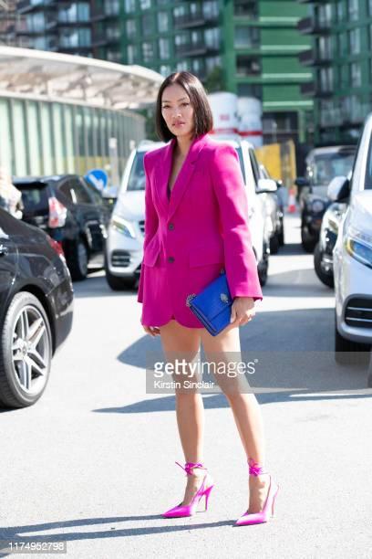 Tiffany Hsu wears The Attico shoes and skirt Balenciaga jacket and a Kurt Geiger bag on September 15 2019 in London England