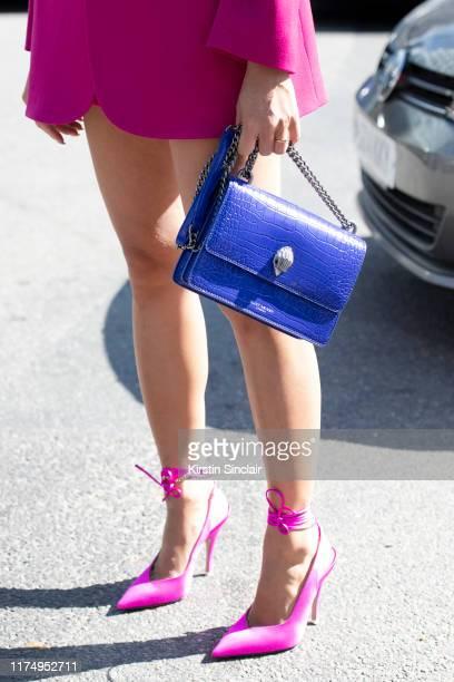 Tiffany Hsu wears The Attico shoes Balenciaga jacket and a Kurt Geiger bag on September 15 2019 in London England