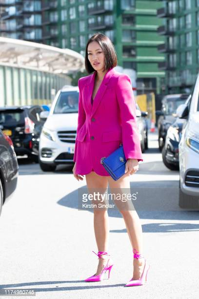 Tiffany Hsu wears The Attico shoes, Balenciaga jacket and a Kurt Geiger bag on September 15, 2019 in London, England.