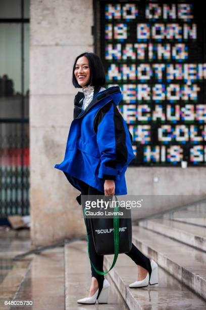 Tiffany Hsu with Balenciaga jacket and OffWhite bag is seen in the streets of Paris after the Mugler show during Paris Fashion Week Womenswear...