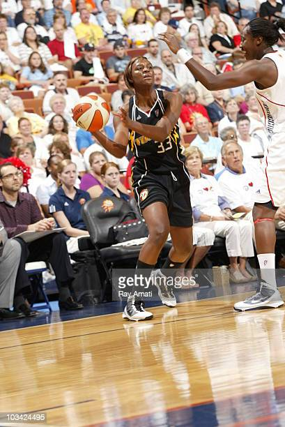 Tiffany Jackson of the Tulsa Shock passes against the Connecticut Sun during the game on August 17 2010 at Mohegan Sun Arena in Uncasville...