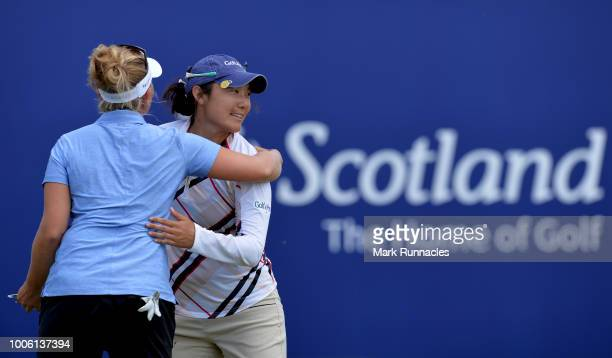 Tiffany Joh of USA is congratulated by Nanna Koerstz Madsen of Denmark at the 18th green after finishing her round at 13 during the second day of the...