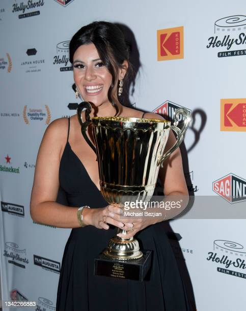 Tiffany K Guillen poses with award at 17th Annual Oscar-Qualifying HollyShorts Film Festival Opening Night at Japan House Los Angeles on September...