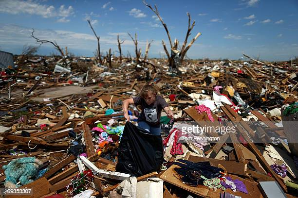 Tiffany Kasper searches through the rubble of her home on May 23 2013 in Moore Oklahoma Kasper and her twoyearold daughter were in the home when the...