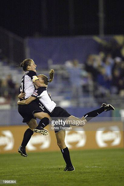 Tiffany Milbrett hugs the winning goal scorer Krista Davey of the New York Power as she scored in the 89th minute against the Boston Breakers at...