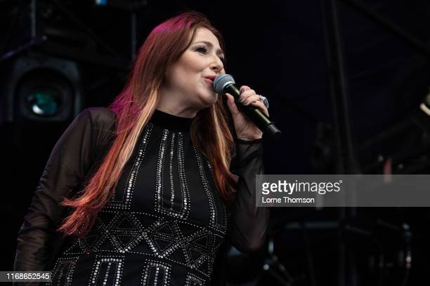 Tiffany performs at Rewind South on August 17 2019 in HenleyonThames England